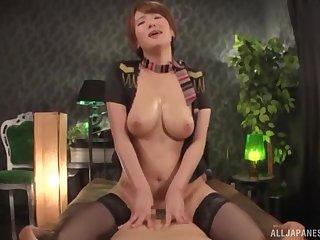 Busty Japanese redhead MILF Natsuki Minami rides a hard cock