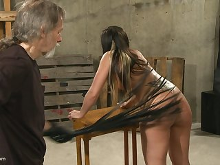 Submissive brunette MILF gets naked to get her round ass spanked