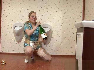 Party slut fucking a bottle with champain