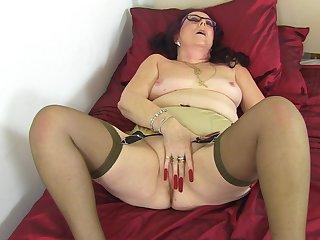 Mature amateur granny with glasses Zadi masturbates with toys
