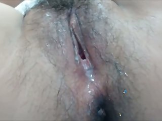 Another great video of a naughty woman with a hairy pussy and ass