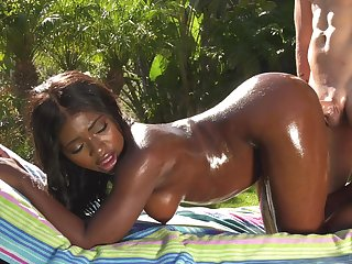 White man gives oiled up ebony babe Noemie Bilas a fantastic backyard bang