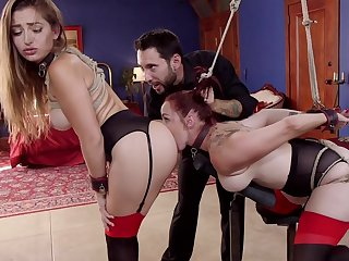 Bound Dani Daniels and Bella Rossi serve as sex slaves for stern Master