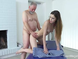 Frisky masseuse is fucking one of the elderly clients because he always gives her money for it