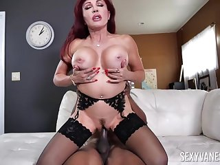 Busty redhead mature Sexy Vanessa enjoys riding a black dick