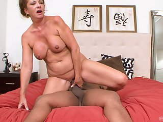 MAture redhead MILF fucked doggy style by a big black cock