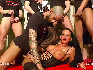 Slut surrounded by cock for a wild gangbang