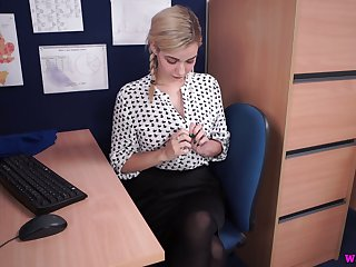 Sweet looking blond secretary Dolly shows off juicy ass and boobies