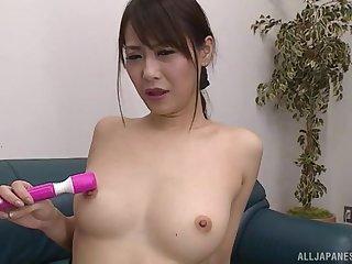 Bossy lady Nanami Hirose adores masturbating in different poses using a dildo